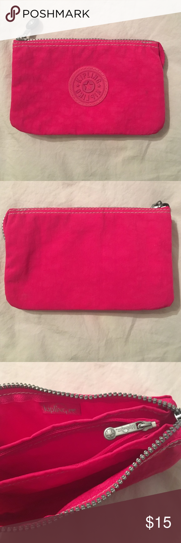 Kipling Zipper Wallet Kipling wallet with two zippers and 3 compartments. New condition. Can be used as a cosmetic case too Kipling Bags Wallets