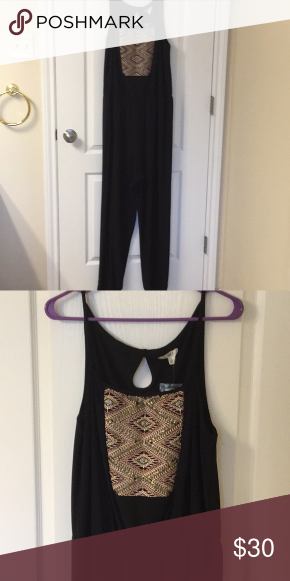 f2daea3a0fe Brand new Black jumpsuit Black jumpsuit with elastic waist and embroidered  and beaded top. Keyhole detail on back. Cato Other