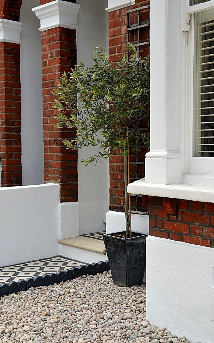 plastered rendered front garden wall painted white metal wrought iron rail and gate victorian mosaic tile path in black and white scottish pebbles york - Front Garden Ideas Terraced House