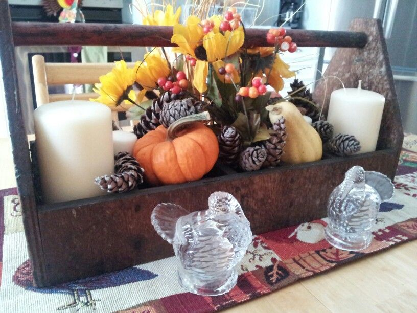 Antique tool box filled with fall decorations. Thanksgiving centerpiece.