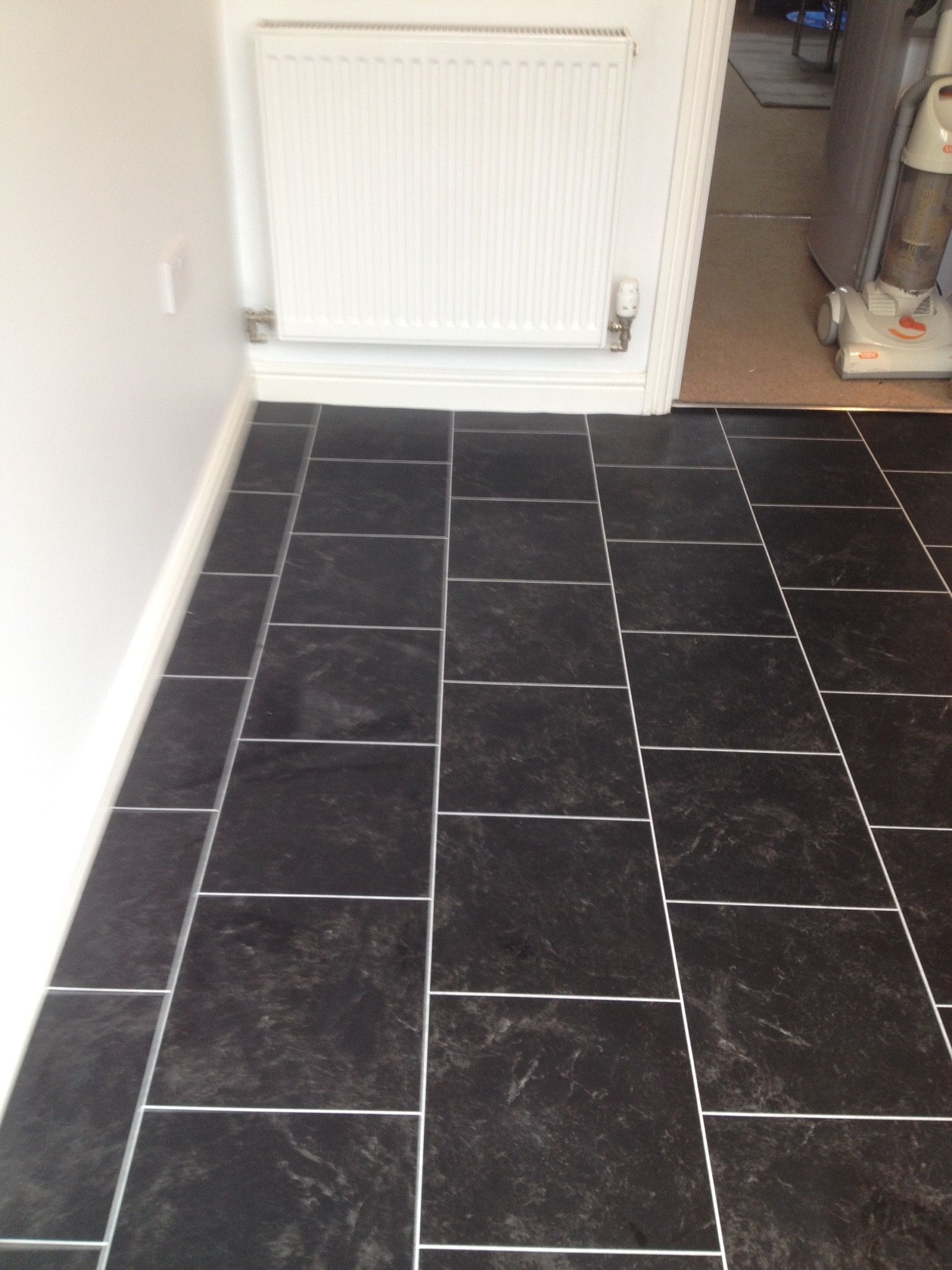Polyflor colonia imperial black marble with an ice grout strip luxury vinyl tile flooring vinyl