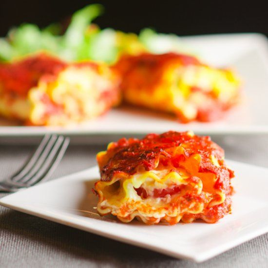 A classic recipe with a twist - Lasagna rolls made from pasta stuffed with marinara sauce, tomatoes and mozzarella cheese.