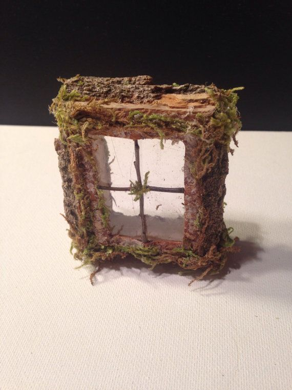What is more whimsical than this little window hanging on a fairy tree? Each is OOAK and approximately 2 1/2 x 2 x 3/4  Please note this is NOT a lighted window.
