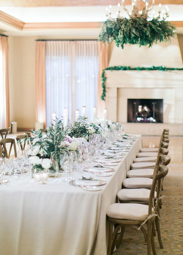 The reception space was swathed in a romantic color palette of soft lilac and gray, with fabulous florals and candlelight turning the reception space into an enchanted affair.