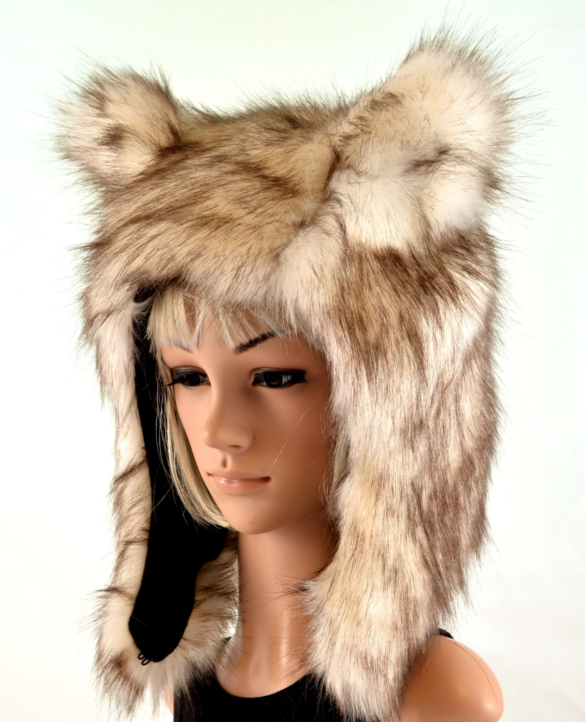 ad850a02b0ec2 This wolf hat is made of a soft natural looking faux fur that has a white  base with subtle brown tips. The inside lining is black fleece.