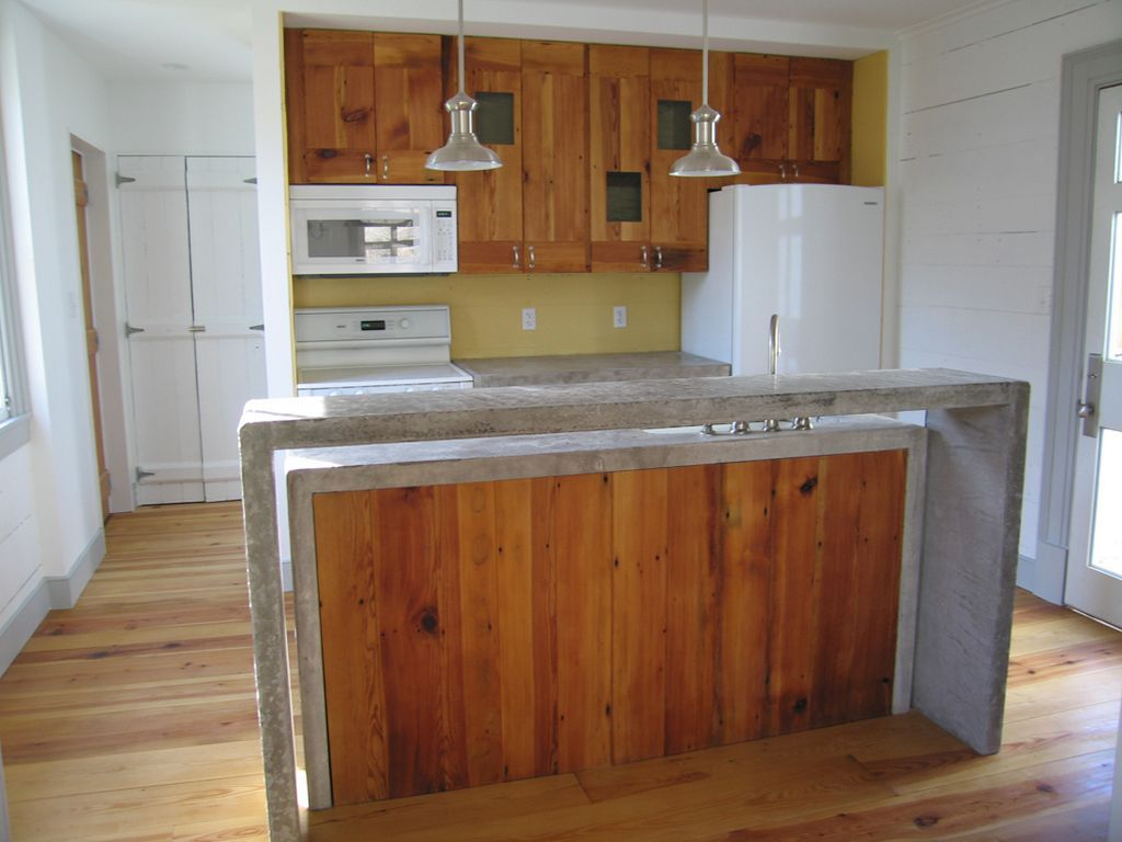 Kitchen of an old farmhouse old farmhouse renovation for Concrete kitchen countertop ideas