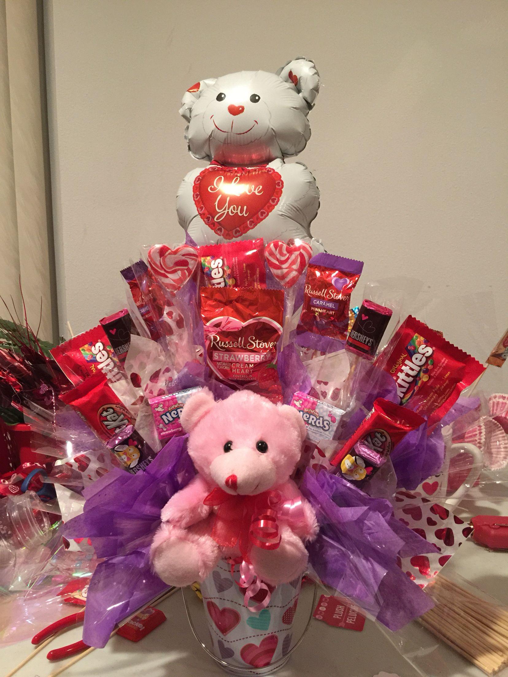 Valentines Day purple tissue candy bouquet in a tin vasa