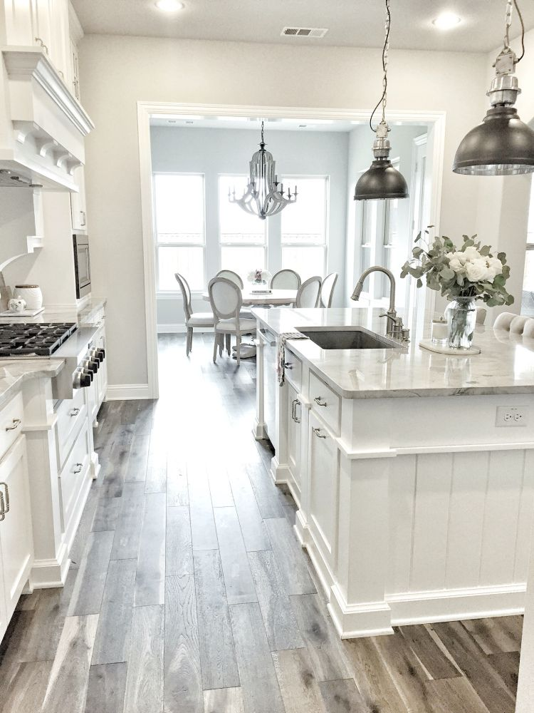 I M Obsessed With This White Kitchen The Pendant Lights And Wood Tile Floor Makes For A Really Gorgeous Room