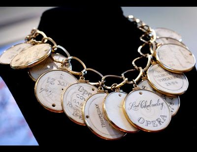 Elizabeth Taylor's gold and ivory necklace featuring ivory opera passes, circa 18th and 19th centuries, a gift from the estate of Edith Head