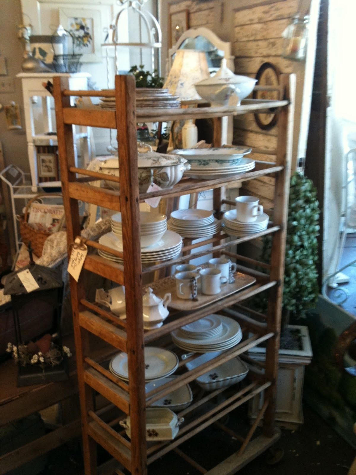 ah may zing vintage shoe rack loaded with ironstone available at american home