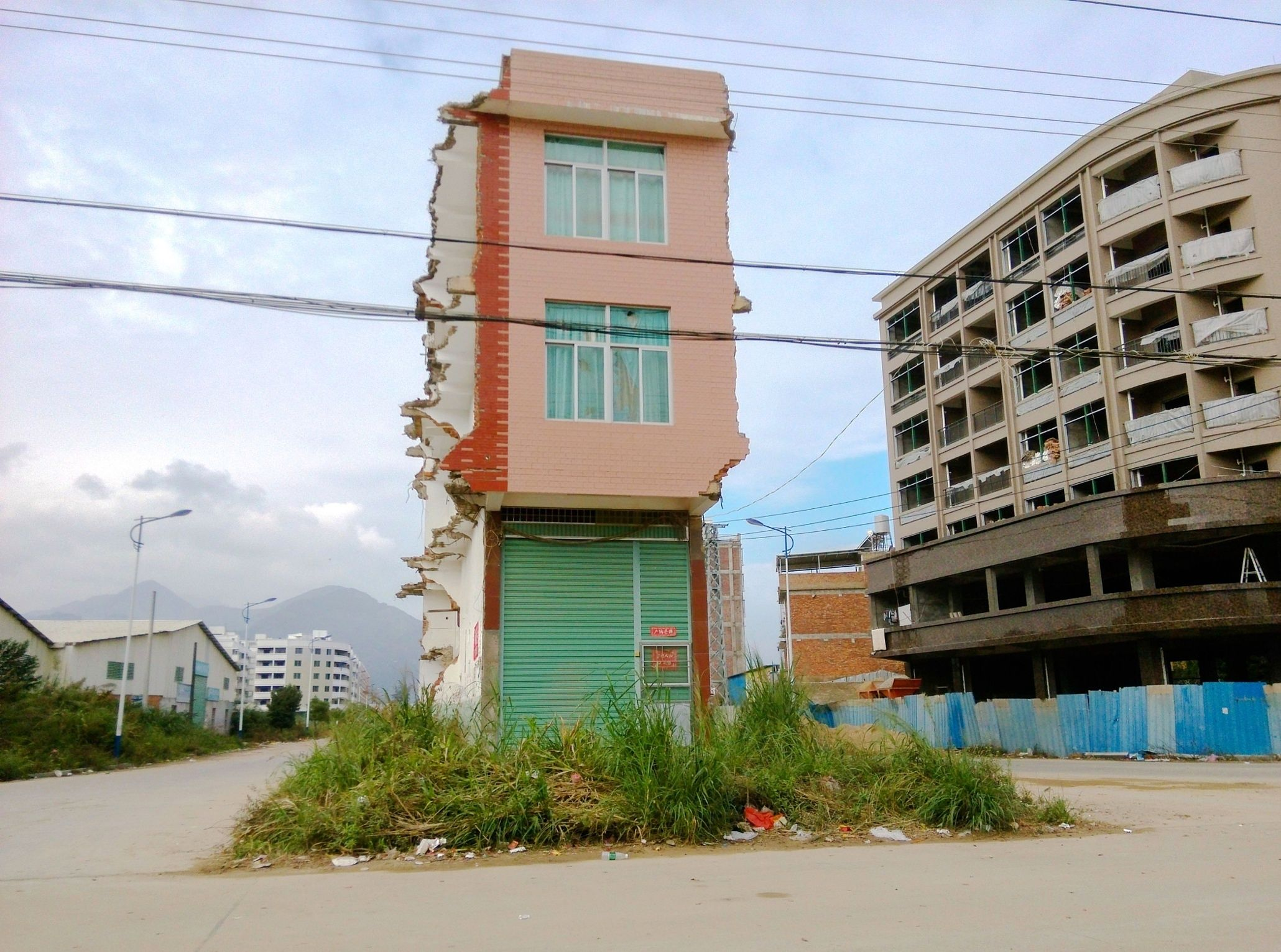 Chinas nail houses the homeowners who refuse to make way in pictures http