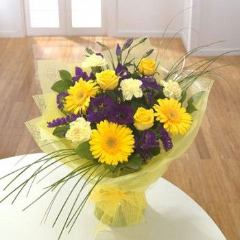 A hand tied bouquet of yellow purple flowers including gerbera a hand tied bouquet of yellow purple flowers including gerbera roses mightylinksfo Gallery