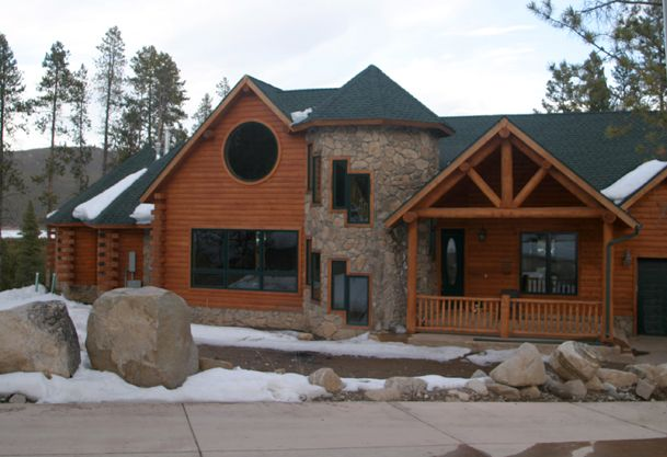 Incredible log home with stone turret i think this is for Log and stone homes