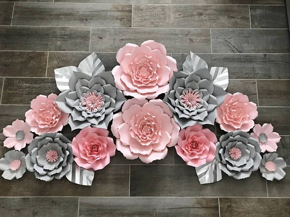 Our larger paper flowers make a beautiful backdrop to any room, party, or event. Each flower is hand cut, sculpted, and assembled. The color combinations are endless. Flowers will have a variety of different flowers ranging in size from to 18 inche