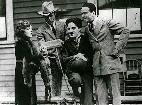 Charlie Chaplin with actress Mary Pickford, actor Douglas Fairbanks, and film director D.W. Griffith on the day they formed United Artists in 1919.