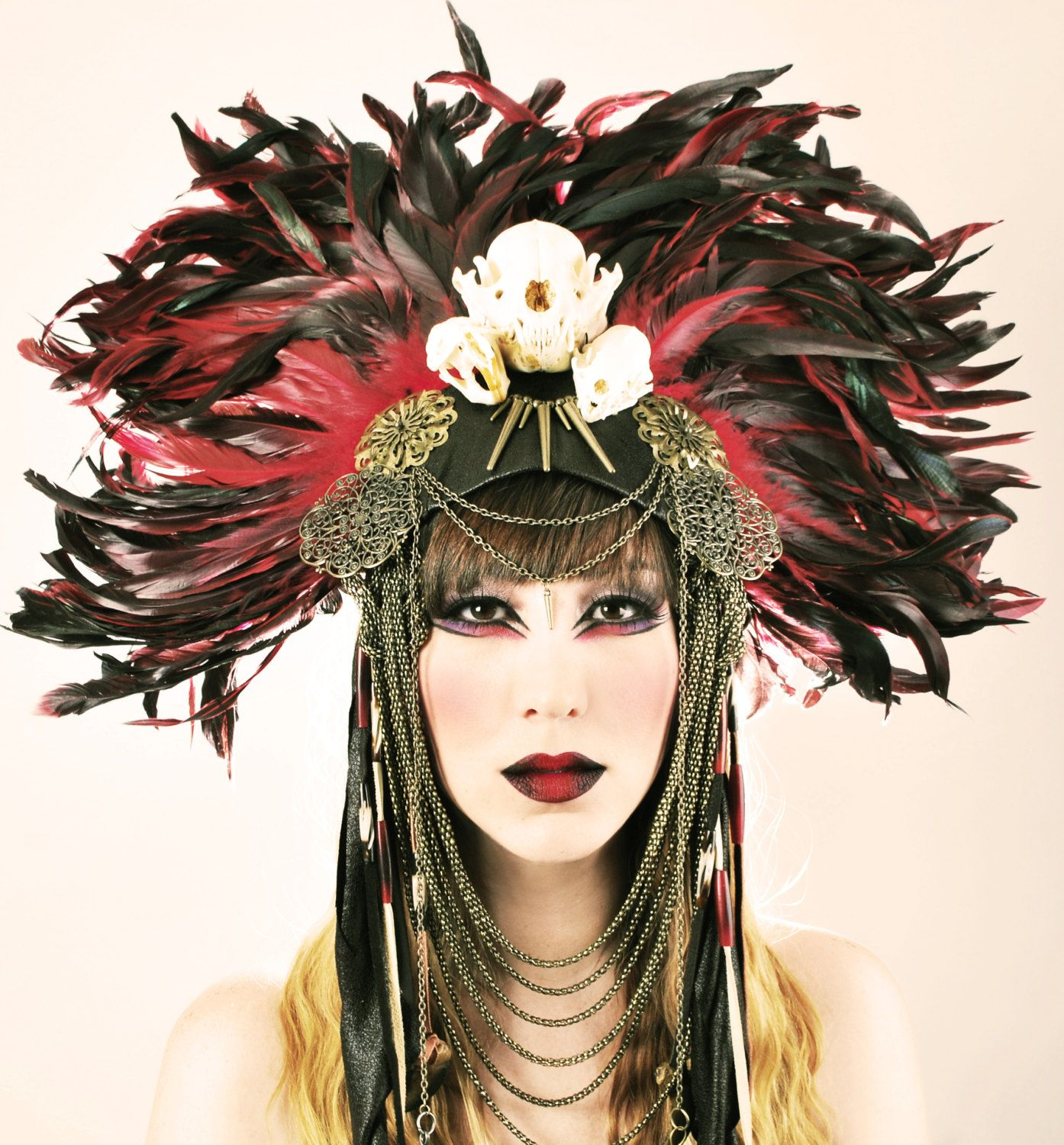 Urban Warrior Feather Headdress with animal skulls. The ...