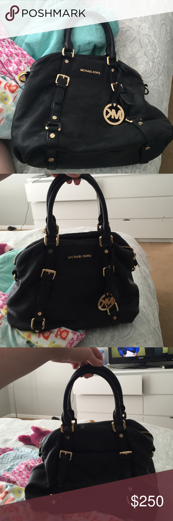 Michael Kors handbag Barely used Michael Kors bowling bag style purse. I paid 495.00 originally for it a year ago and have barely used it. No stains and in great condition. Michael Kors Bags Satchels