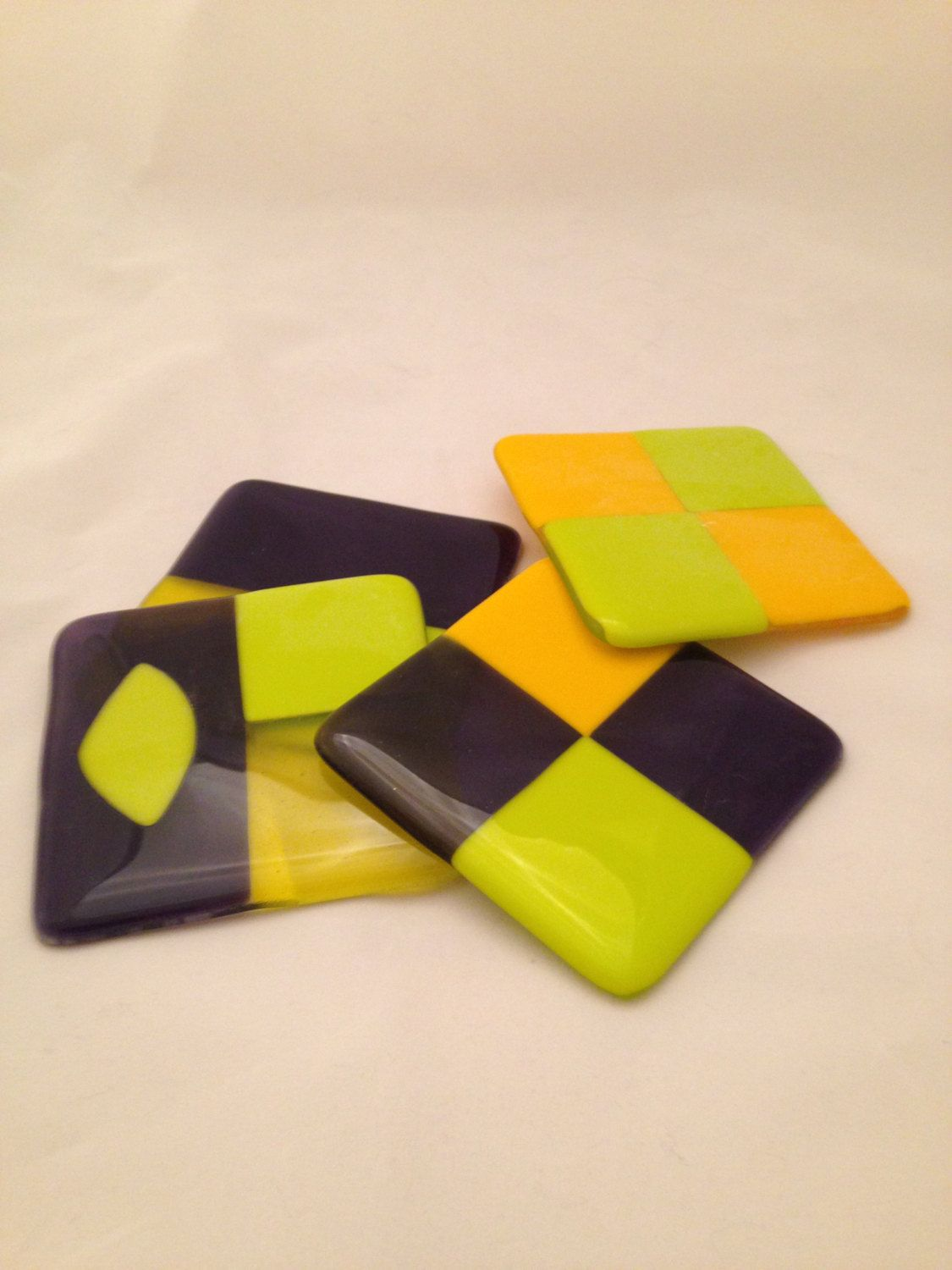 Fun fused glass coasters in purple yellow and lemony-green.  Set of 4.  Great for you or as a gift from you. - pinned by pin4etsy.com