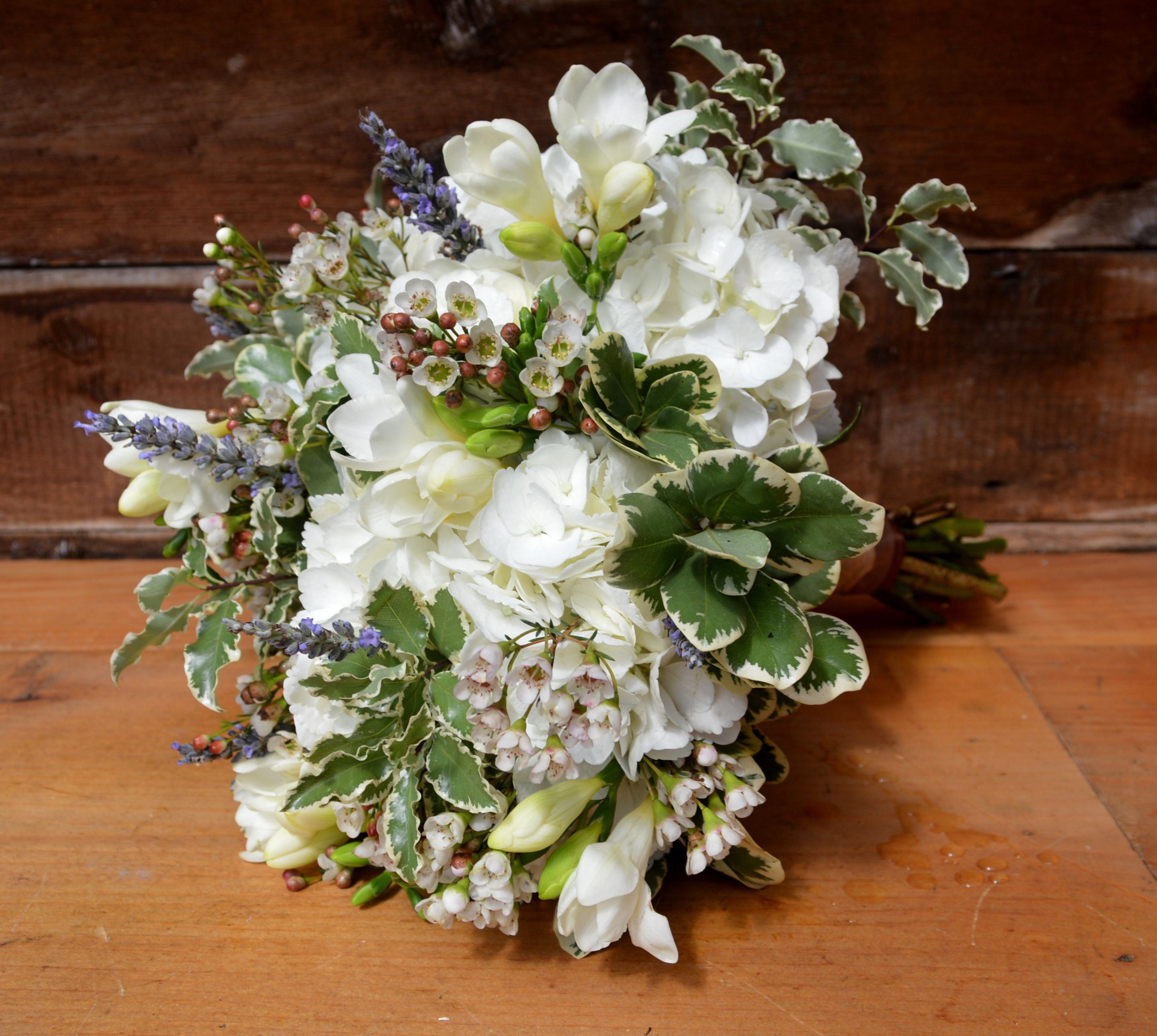 Rustic wildflower bridal bouquet including white hydrangea white rustic wildflower bridal bouquet including white hydrangea white freesia lavender and wax flower izmirmasajfo Gallery