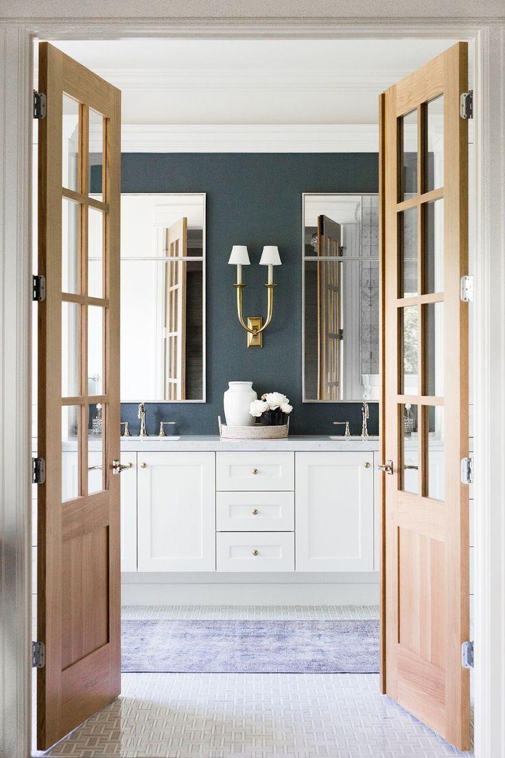 Traditional master bath with open doors and dark navy wallpaper double sconce double vanity | Studio McGee Design hid360.com