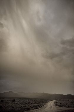 mesa road before the storm - by geraint smith