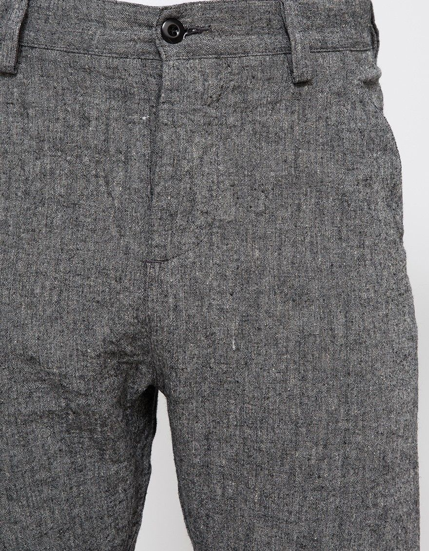From wings+horns, a linen pant in Charcoal. Features button fly, belt loops, front slanted pockets, back patch pockets with flap and button closure, straight leg and classic fit.   •Linen pant in Charcoal •Button fly •Belt loops •Front slanted po