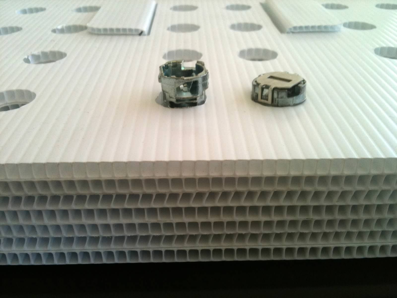 Plastic Corrugated Insert Dunnage Multilayered Pad With Punches To Pack Metal Rod Like Components Orbis Madr Industrial Packaging Corrugated Metal