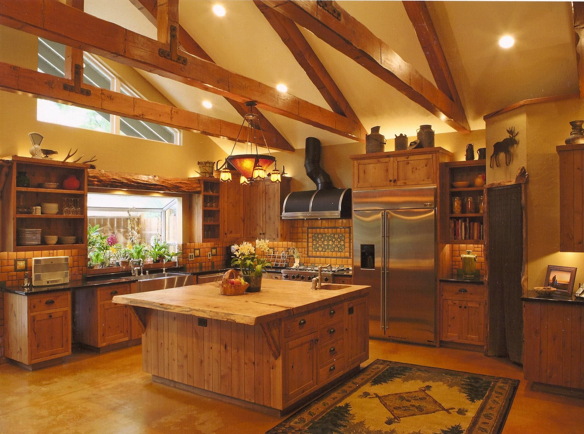 Pendant lights and stainless appliances highlight this log ...