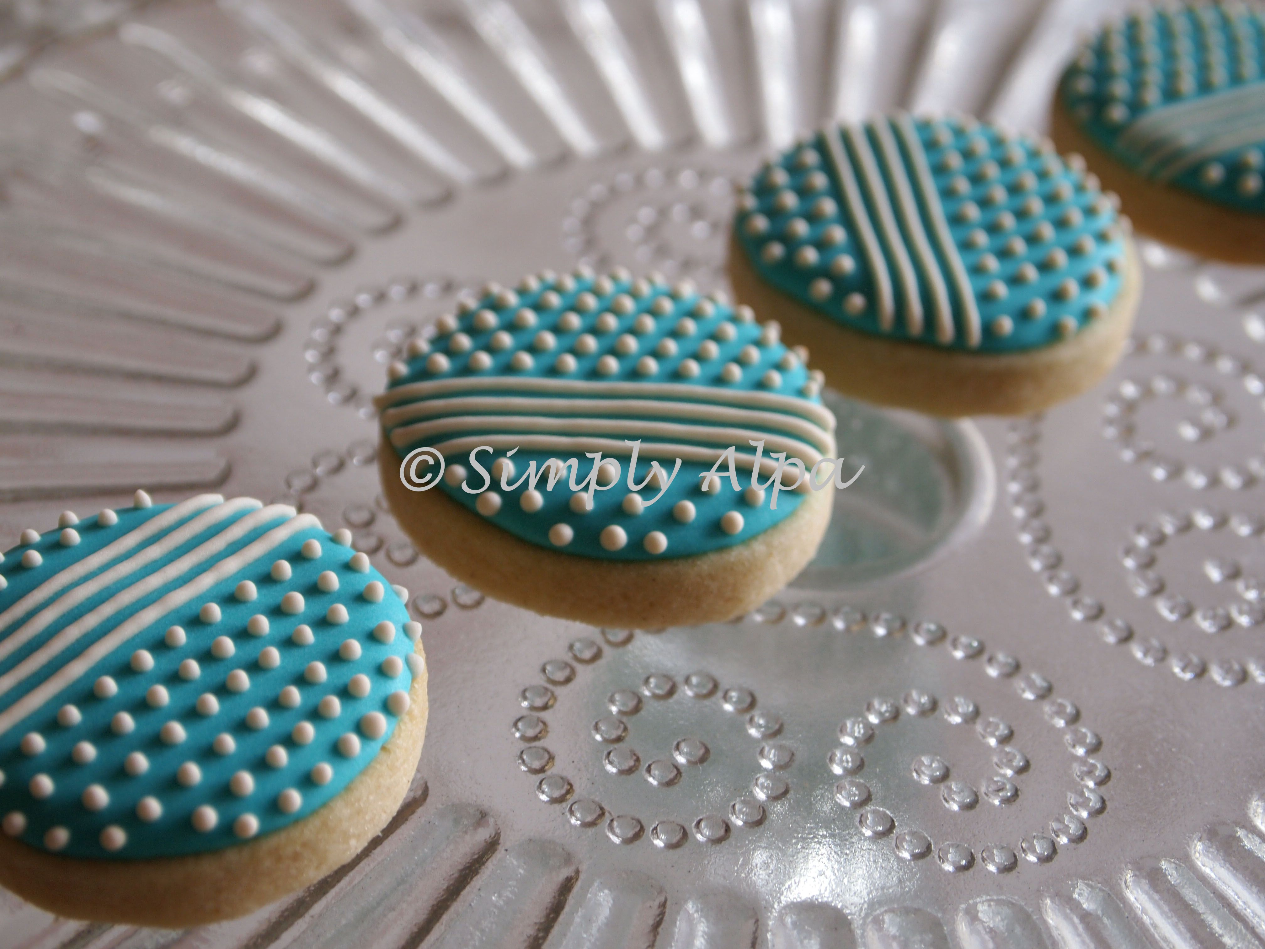 Teal round cookies with lines and dots, simple but effective