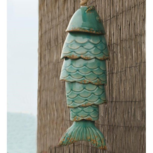 Colored Porcelain Koi Fish Wind Chime is part of garden Art Wind Chimes - Colored porcelain Koi fish wind chime will be your best catch of the season  Hanging from your porch or deck, like they've just been caught from ancient Japanese waters, these weatherresistant and artistic wind chimes will create deep, relaxing tones every time the wind blows  In Japanese culture, Koi fish represent loyalty, friendship and love, making this outdoor garden art not only pleasing to the eyes an ears, but symbolic as well  Crafted with porcelain and clay to appear aged, these unique chimes feature detailed fins, tails, eyes and lips  Hang these serene yet brightly hued Koi fish near your yard or garden retreat to instill the calming nature of the sea in your outdoor décor