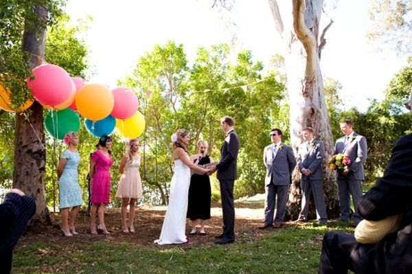 love it! who said bridesmaids are supposed to hold flowers!?!