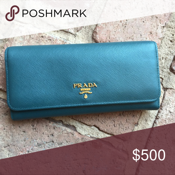 ffb7d75f6a90 Authentic Prada Saffiano Wallet - Ottanio Authentic Prada Saffiano Wallet.  Includes snap-in card holder on gold chain. Color is Ottanio.
