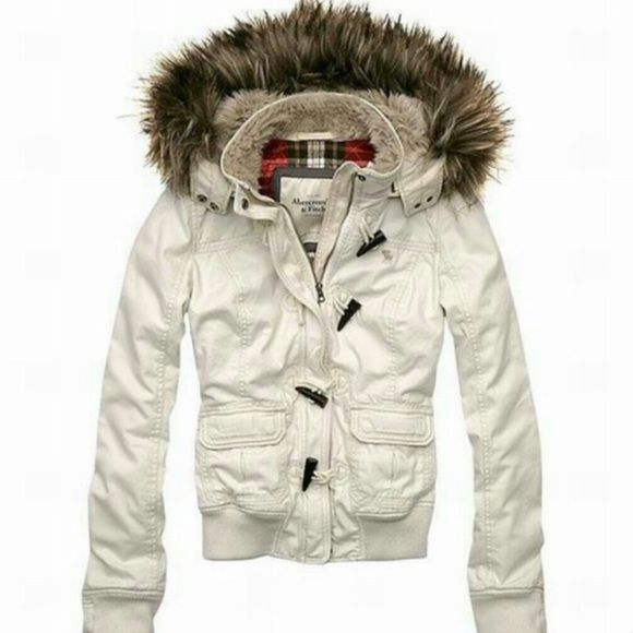 Abercrombie & Fitch Eden Jacket Worn, but still in good condition. Thick, so it'll keep you very warm for the cold seasons. Oversized removable hoodie with fur trimming. Color is more of a ivory/ off white. Very cute! Abercrombie & Fitch Jackets & Coats