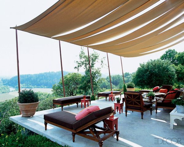cloth swag roof. love chocolate brown cushions - such a practical color - Designers Jeffrey Weisman and Andrew Fischer, Photo Grey Crawford