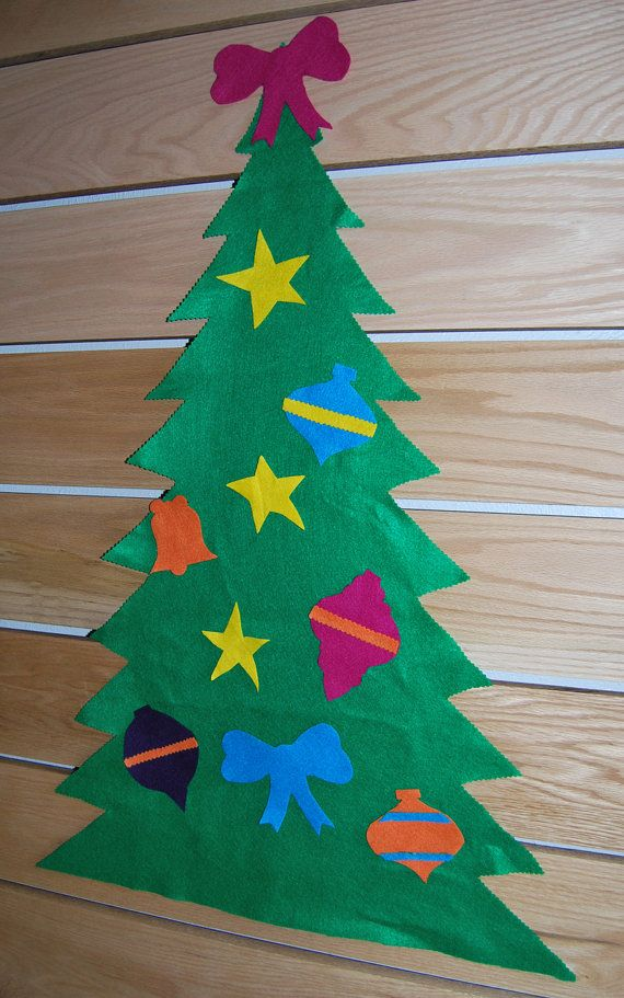 "$20 - Felt Christmas Tree is approximately 3 feet tall and comes with 10 ornaments. Ornaments can be attached/removed over and over with no need for adhesive of any kind, so you can use them again and again for years to come. These trees add a festive touch to your wall for the holidays with the added bonus of giving your little ones something creative to do when ""the weather outside is frightful"". #holidaydecor #christmas #christmastree #toddleractivities #coldweatheractivities"