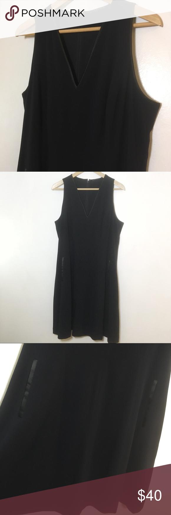 T Tahari Black Sleeveless Dress Sleek Black Tank Dress With Satiny Trim From T Tahari V Neck Collar Black Sleeveless Dress Black Tank Dress Sleeveless Dress [ 1740 x 580 Pixel ]