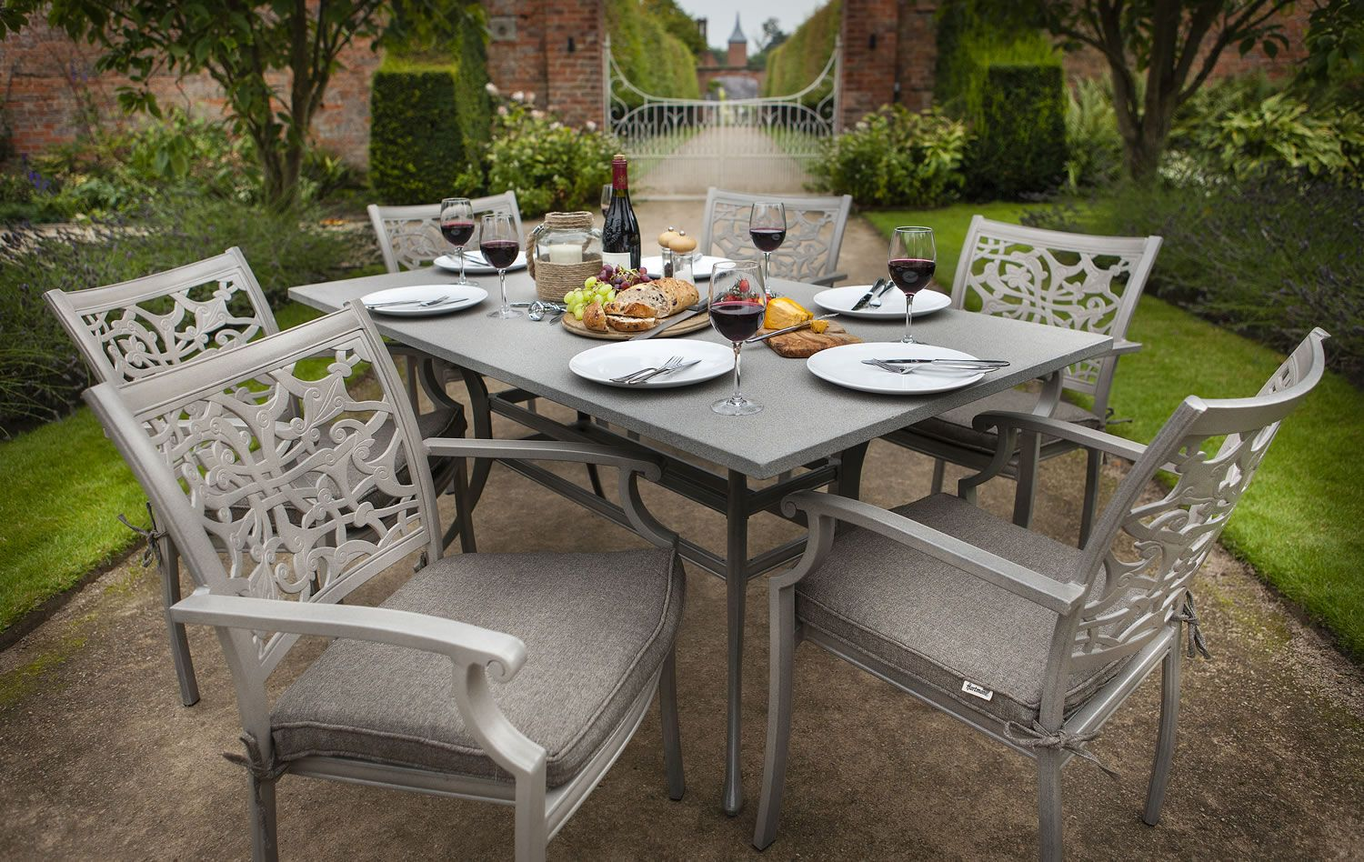 View the hartman celtic 6 seater rectangular set in riven with spraystone table top outdoor stone