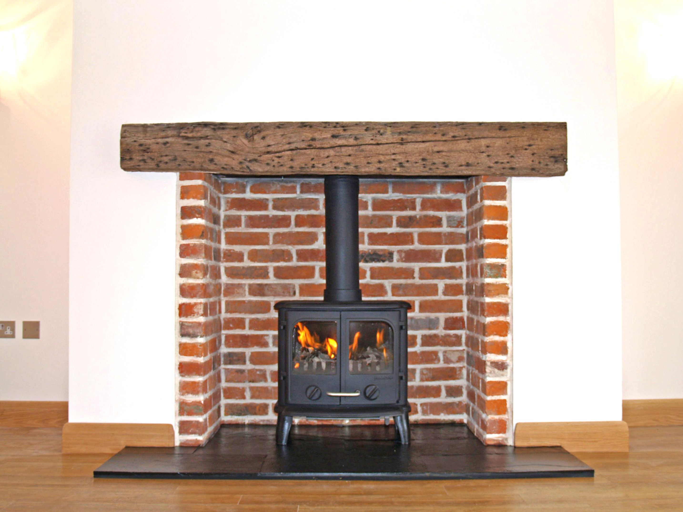 reclaimed brick chamber with reclaimed clad oak beam natural