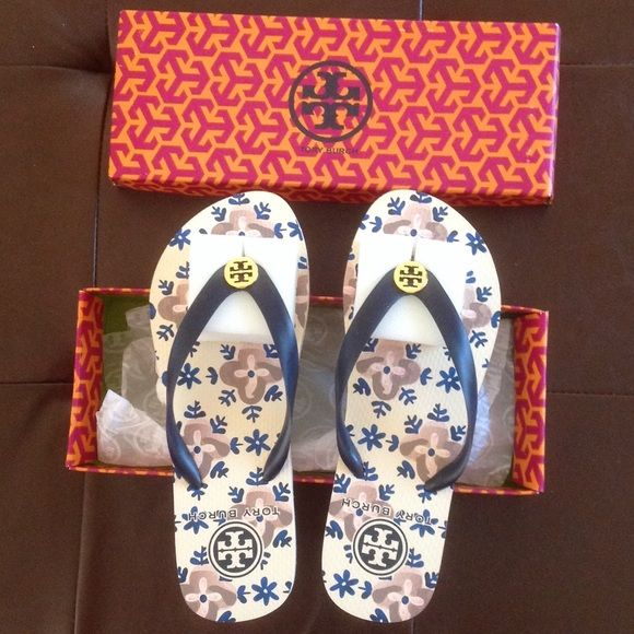 Tory Burch flip flops Brandnew never been worn. Size 8, comes in original box.  No tag attached. Tory Burch Shoes