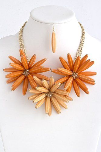 """Orange Acrylic Flower Statement Necklace With Gold Chain Link Necklace - Orange Acrylic Flower Drape Necklace With Gold Accent StarShine Jewelry. $26.00. Lead compliant. Flower 3.5"""" x 3.5"""". Length approx 20"""". Lobster claw clasp with 3"""" extender. Acrylic flower statement necklace"""