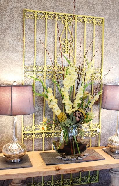 Repurposed wrought iron fence looks lovely in yellow...