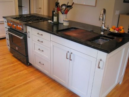 island with Kohler stages sink in renovated black and white kitchen ...