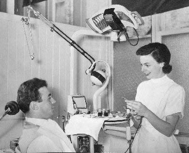 Final year dental student in the Department of Conservative Dentistry treating a patient, c. 1960.
