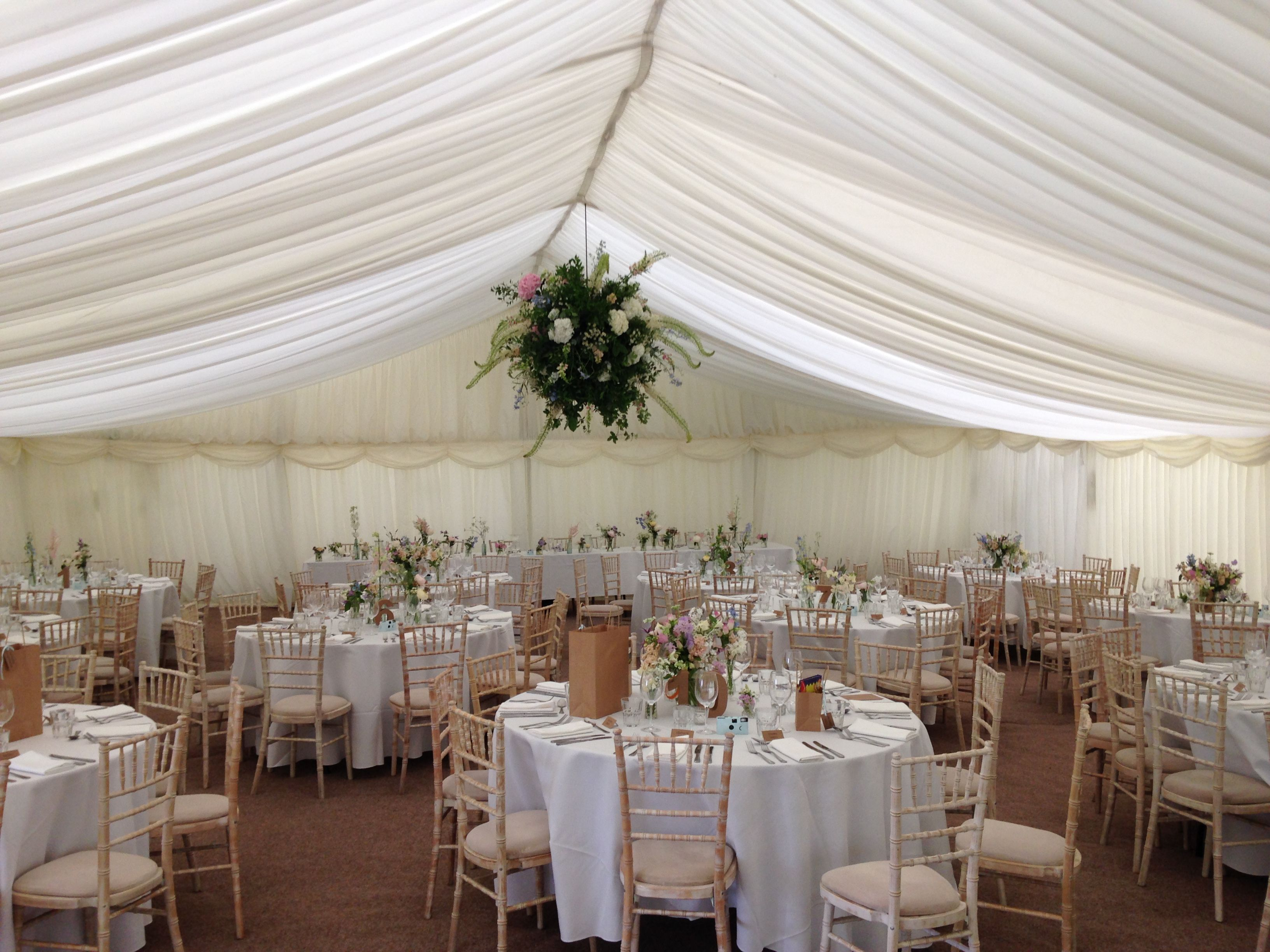 Country style wedding with suspended flower ball in a frame marquee alresford marquees specialises in marquee hire wedding marquees party marquees and corporate marquee hire across hampshire surrey sussex berkshire junglespirit Choice Image
