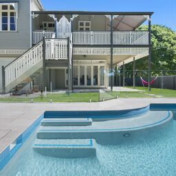 Frameless Glass On Beautiful Brisbane Queenslander Installed By Htm Homescapes Glass Pool Glass Pool Fencing Pool Builders