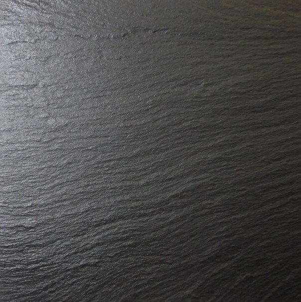 black table top. slate textured or black wood table texture. top m