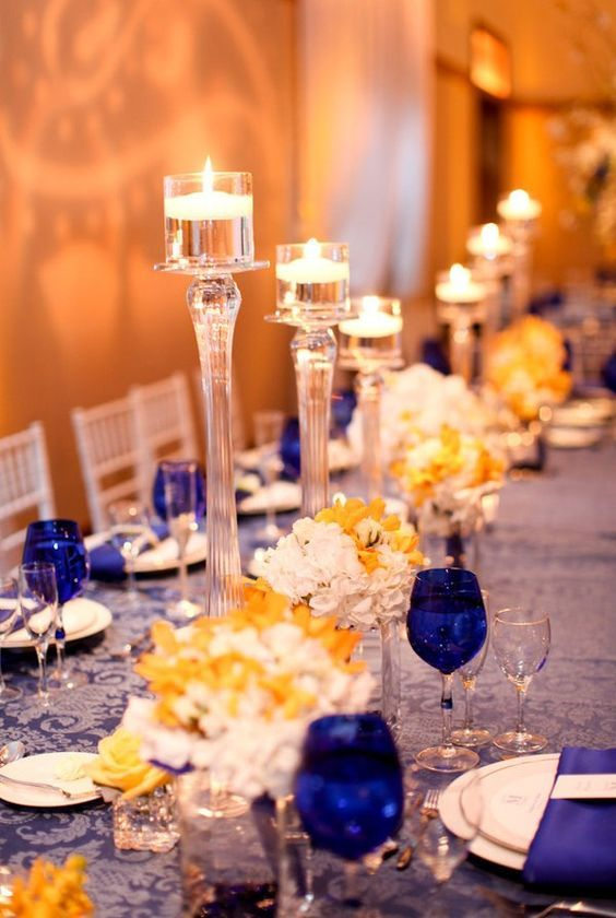 77549acb636 A blue and yellow colour scheme is perfect for a Beauty and the Beast  themed wedding