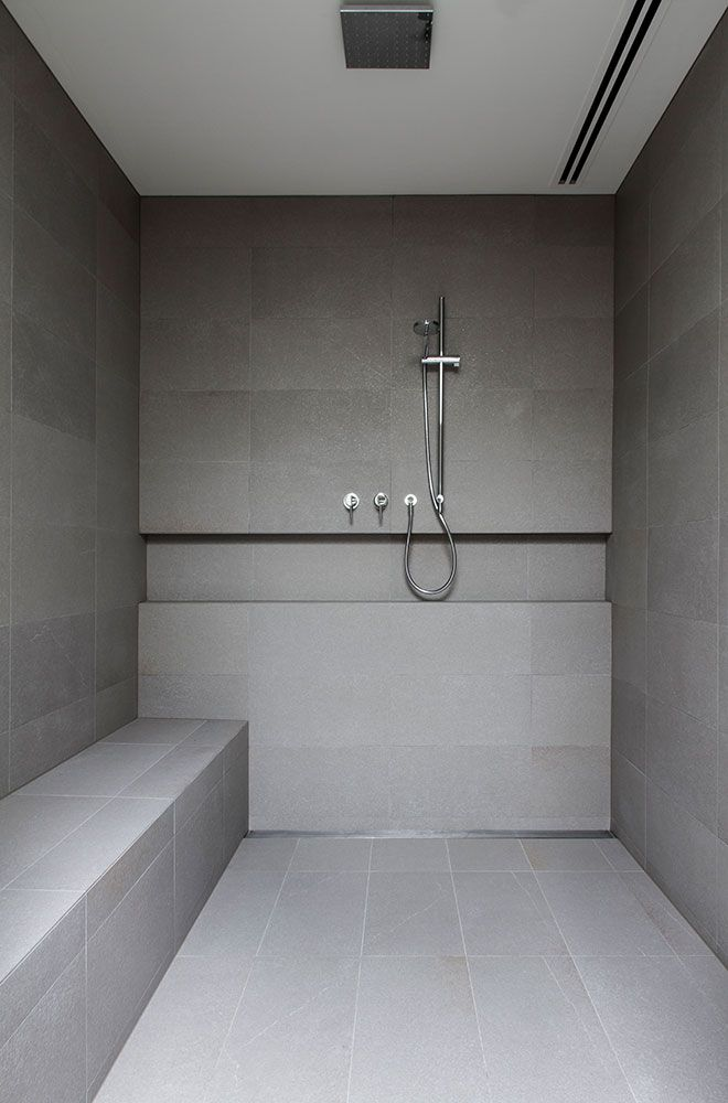 Shower With Built In Shelf And Seat In Natural Finish Tile At