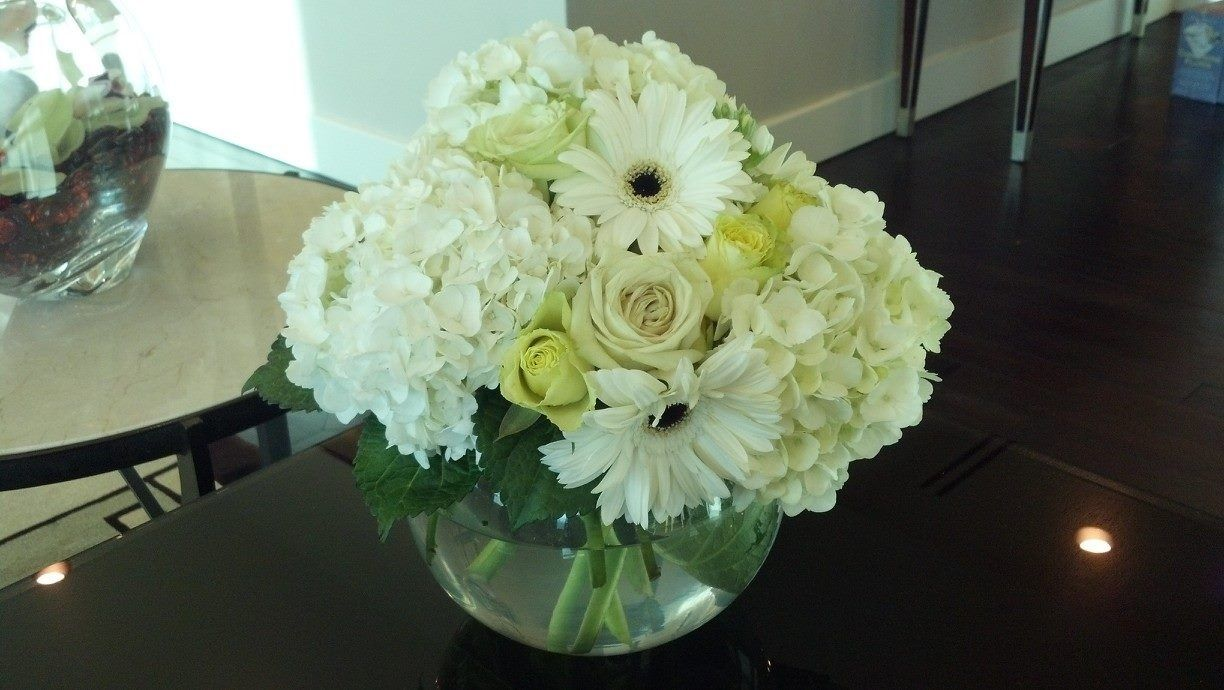 Hydrangea and rose arrangement for a wedding.