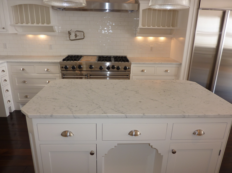 White Subway Tile And Carrara Marble Countertops Marble